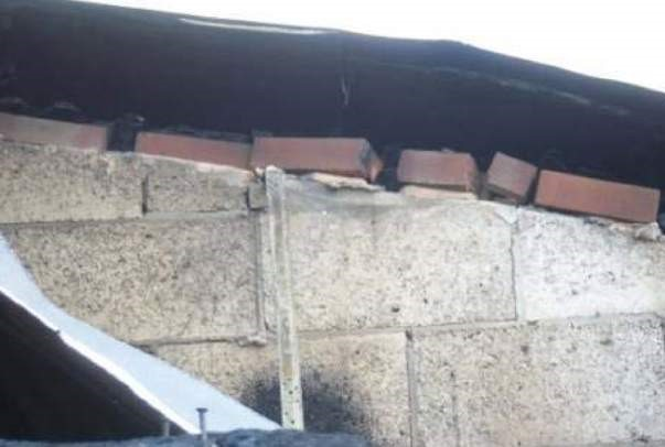 Attempt to provide fire stopping in curved section of wall.jpg