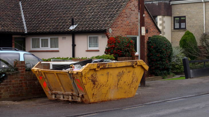 Hiring a skip when clearing your house out - Designing