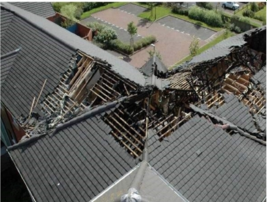Aerial view showing damage to roof structure.jpg