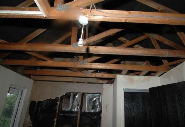 File:Top floor of property showing fire damage to party wall.jpg