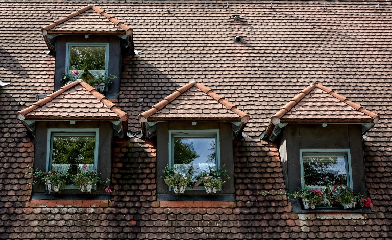 Hip roof: The roof comprises of three sloping panels that meet at the ...