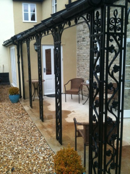 File:Wrought iron porch.jpg