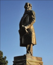 Bronze statue of Sir Titus Salt in Roberts Park.jpg